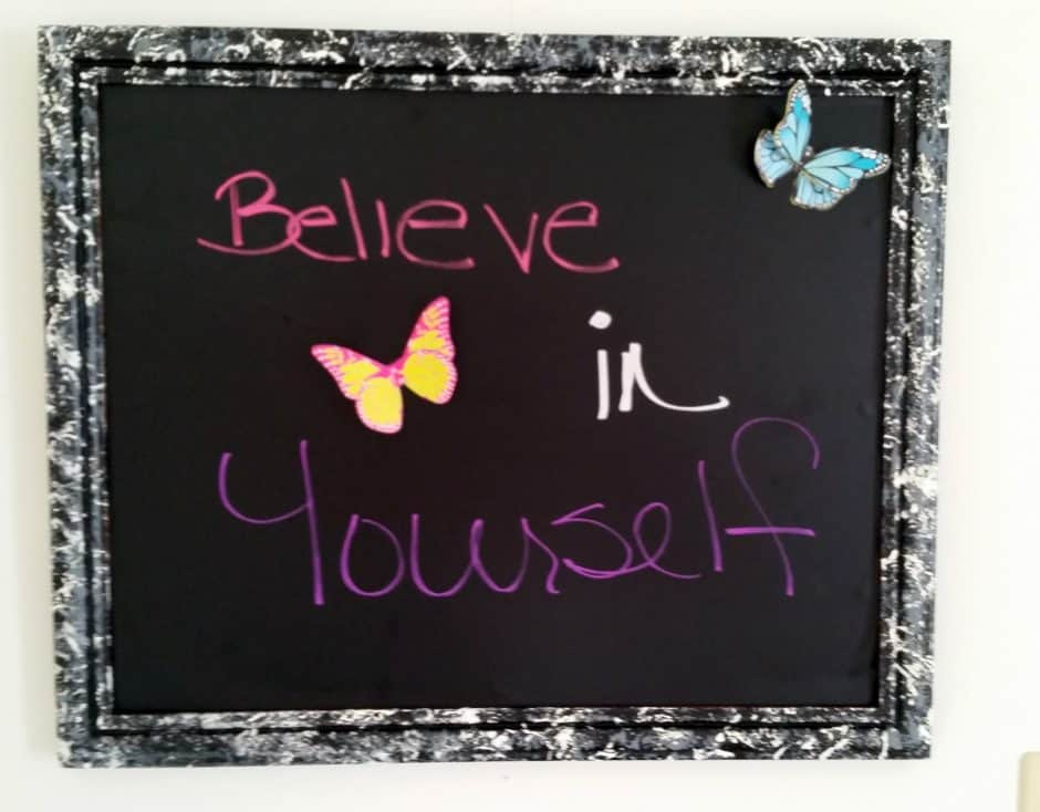 upcycled chalkboard collage photo frame with marbled background and the words believe in yourself written on it with butterflies