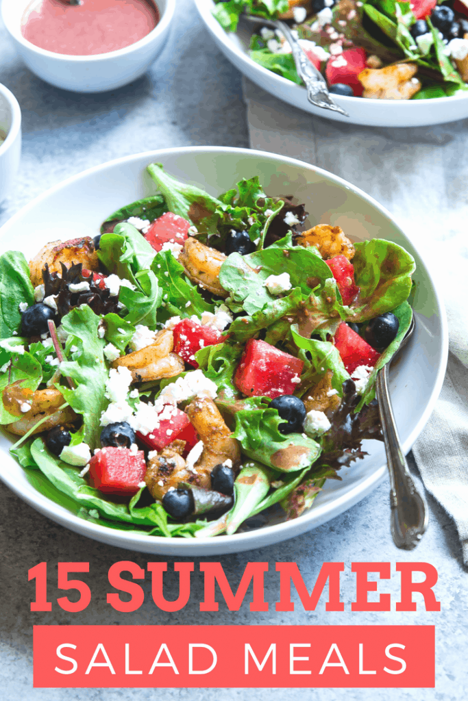 two plates of delicious summer salad meal sitting on a table - Text is 15 summer salad meals