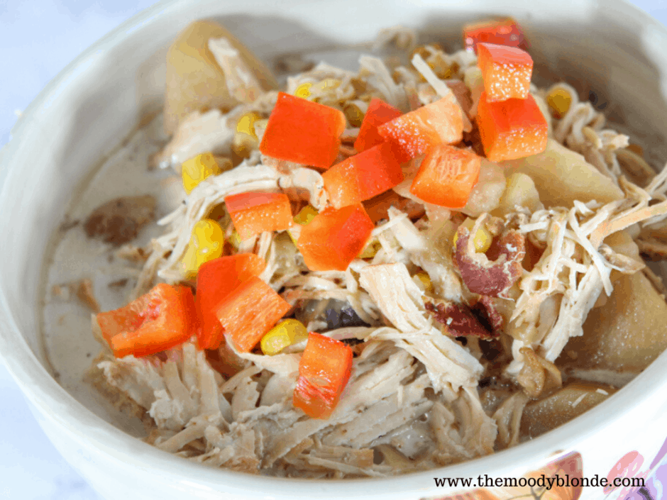 Hearty chicken bacon corn chowder in a white bowl