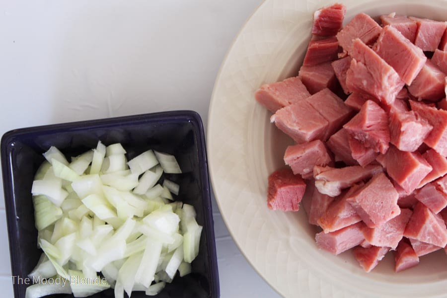 ham and onion in a black and white bowl