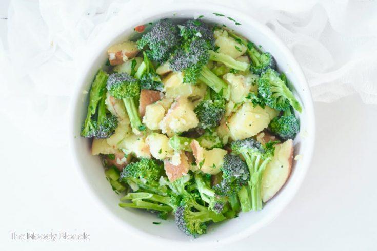 broccoli and potato salad in a white bowl