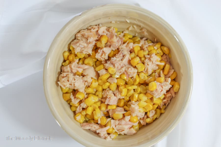 Corn and Tuna mixed in a beige bowl